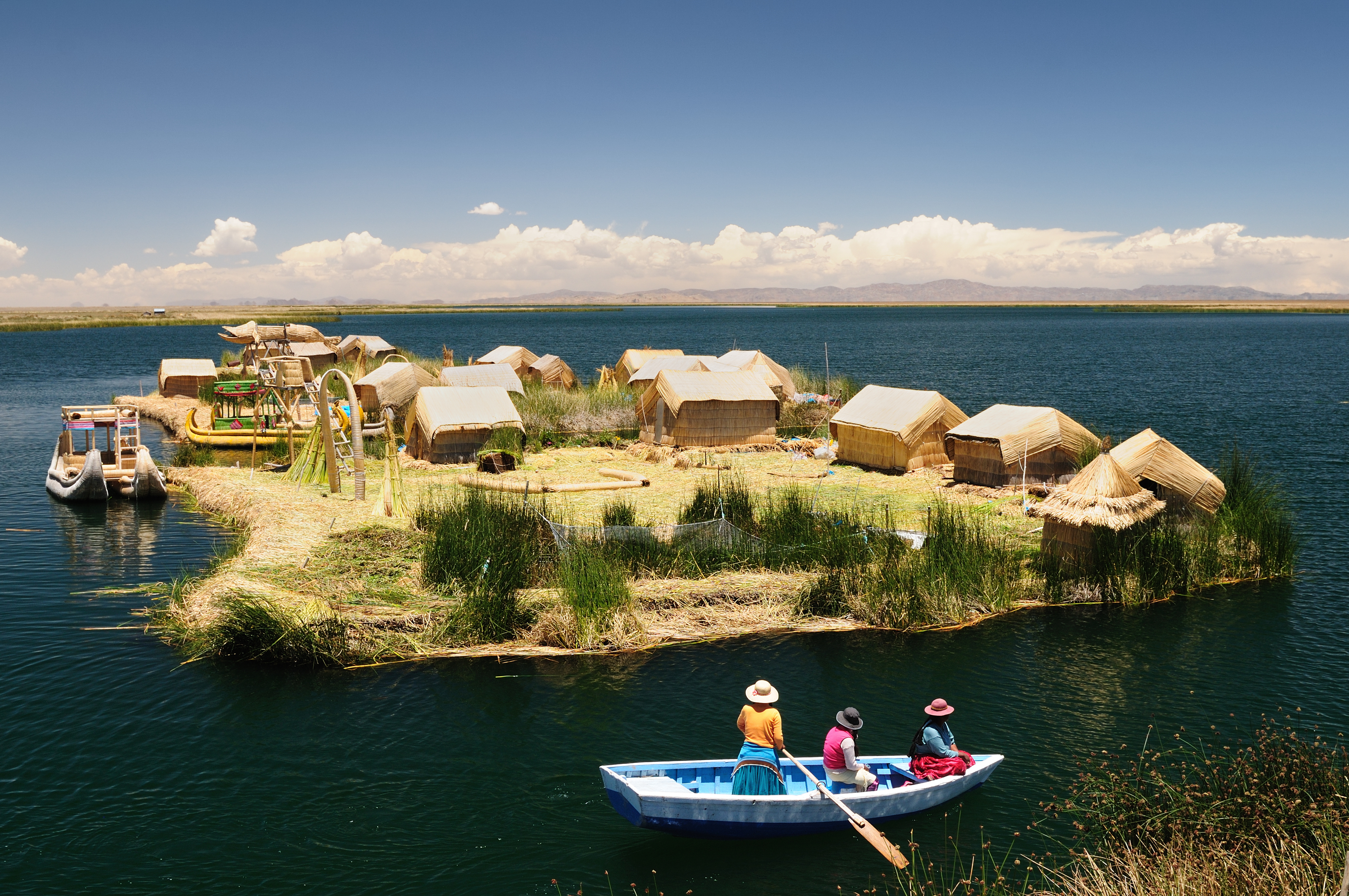 floating Uros islands on the Titicaca lake, the largest highaltitude lake in the world (3808m). Theyre built using the buoyant totora reeds_96802072